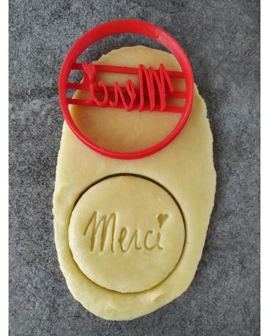 """Biscuit sablé rond avec écrit """"MERCI"""""""