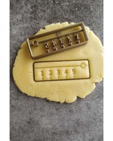 Biscuit sablé en forme de règle scolaire
