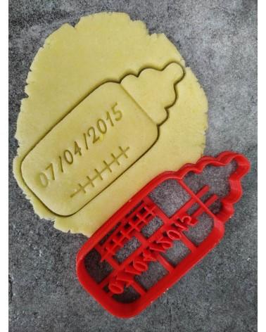 Biscuit sablé en forme de biberon personnalisé avec une date
