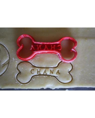 Biscuit sablé en forme d'os pour chien personnalisé avec un prénom